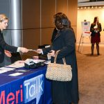 Attendees check in at the MeriTalk registration table.