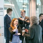 Speakers, attendees, and exhibitors share conversations during networking breaks