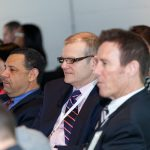 """Members of the audience listen intently as speakers share their perspective during the """"Shrinking the Footprint"""" panel"""