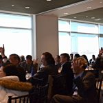 Attendees actively participate in the discussion on combating Federal fraud and improper payments.