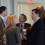 Attendees interact with their government and industry colleagues during a networking break.
