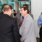 Attendees share a laugh during a networking break.